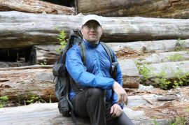 Author and hiker, John Abela, wearing a Montbell Tachyon Wind Jacket, Montbell Dynamo Wind Pants, Headsweats Long Bill Hat, and ZPacks Arc Blast backpack.