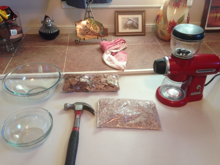 Started with the large bag of dried banana purée (310g) and took a hammer to it to break the pieces down small enough to fit into a burr grinder.