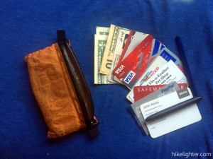 The typical around-town contents of my ZPacks Zip Pouch. While out on the trail, small cash denominations, less plastic cards and more trail name/info cards and medical info.