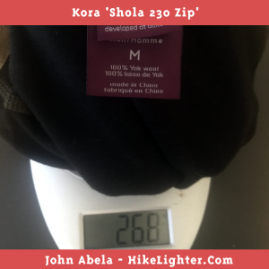 The weight of my medium sized Kora Shola 230 Zip is 268 grams.